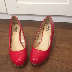 """Red patent """"leather"""" pumps"""